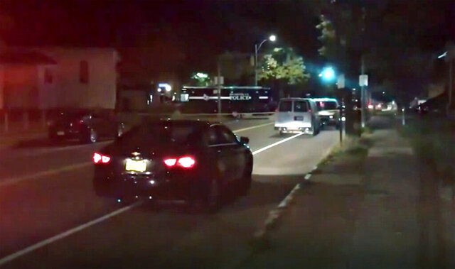 Police respond to the scene of a shooting early Saturday, Sept. 19, 2020 in Rochester, N.Y.  As many as 100 people were at a backyard party when the shooting started just before 12:30 a.m., Acting Police Chief Mark Simmons told reporters.  (13 WHAM via AP)