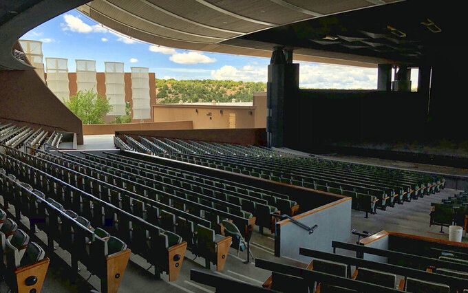 FILE - In this May 8, 2019, file photo, the Santa Fe Opera awaits its summer season in Santa Fe, N.M. The gates at the famed Santa Fe Opera are opening again. General Director Robert Meya said Wednesday, June 2, 2021, during a news conference that he and the entire company are excited to return to the stage next month. (AP Photo/Morgan Lee, File)