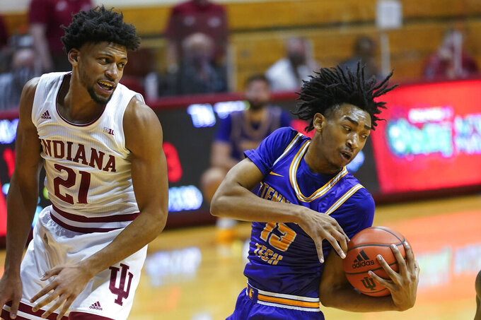 Tennessee Tech's Kenny White Jr. (13) grabs a rebound against Indiana's Jerome Hunter (21) during the first half of an NCAA college basketball game, Wednesday, Nov. 25, 2020, in Bloomington, Ind. (AP Photo/Darron Cummings)