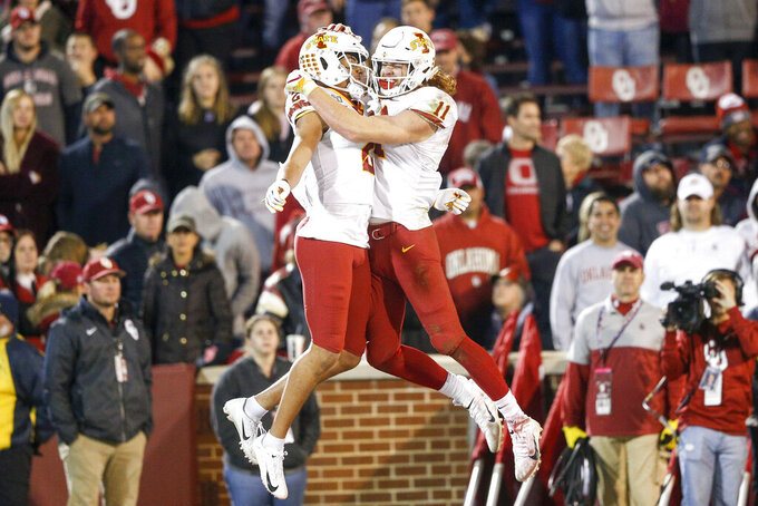 Iowa State Cyclones wide receiver Sean Shaw Jr. (2) and tight end Chase Allen (11) celebrates after Shaw's touchdown catch during the NCAA football game between the against the Iowa State Cyclones and the Oklahoma Sooners at Gaylord Family-Oklahoma Memorial Stadium in Norman, Okla., on Saturday, Nov. 9, 2019. (Ian Maule/Tulsa World via AP)
