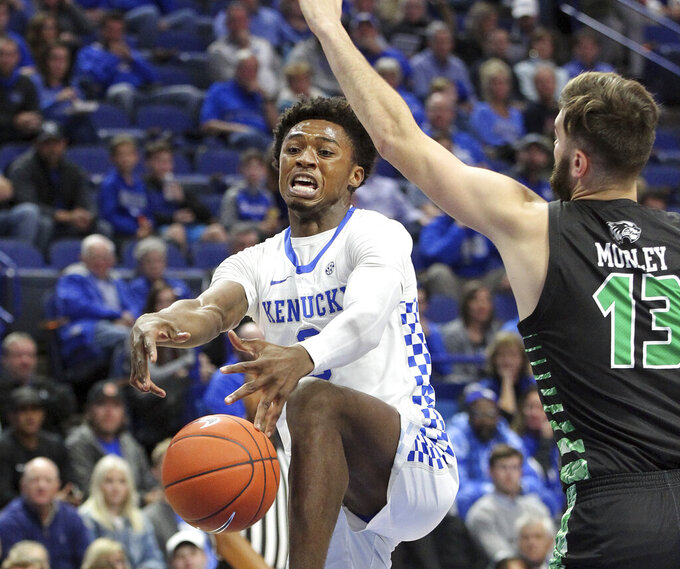 Kentucky's Ashton Hagans, left, loses the ball near Utah Valley's Brandon Morley (13) during the first half of an NCAA college basketball game in Lexington, Ky., Monday, Nov. 18, 2019. (AP Photo/James Crisp)