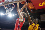 Southern California forward Onyeka Okongwu, right, blocks a shot by Utah center Branden Carlson during the second half of an NCAA college basketball game Thursday, Jan. 30, 2020 in Los Angeles. (AP Photo/Kyusung Gong)