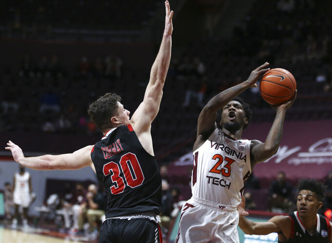Virginia Tech's Tyrece Radford (23) shoots past VMI's Sean Conway (30) during the first half of an NCAA college basketball game in Blacksburg, Va., Thursday, Dec. 3 2020. (Matt Gentry/The Roanoke Times via AP, Pool)