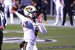 Missouri quarterback Connor Bazelak (8) passes against Mississippi State during the second half of an NCAA college football game, Saturday, Dec. 19, 2019, in Starkville, Miss. (AP Photo/Rogelio V. Solis)