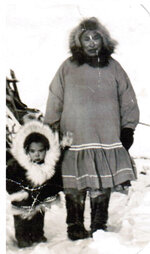 This undated photo shows a young Chris Kiana, left, with his grandmother in Selawik, Alaska. Kiana, who served in the Navy during the Vietnam War, is critical of a new government program that will allow Native veterans to apply for land that they might have missed out on in earlier programs because of their service. (Photo provided by Chris Kiana via AP)