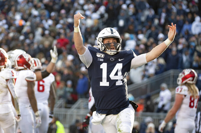 Penn State quarterback Sean Clifford (14) celebrates his touchdown against Indiana during the fourth quarter of an NCAA college football game in State College, Pa., on Saturday, Nov.16, 2019. Penn State defeated 34-27. (AP Photo/Barry Reeger)