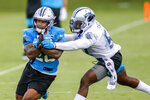 Carolina Panthers running back Mike Davis, left, pulls in a catch against Carolina Panthers linebacker Andre Smith during NFL football training camp practice Sunday, Aug. 16, 2020 in Charlotte, N.C. (AP Photo/Nell Redmond)