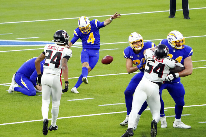 Los Angeles Chargers kicker Mike Badgley (4) kicks a game-winning field goal during the second half of an NFL football game against the Atlanta Falcons Sunday, Dec. 13, 2020, in Inglewood, Calif. (AP Photo/Jae C. Hong)