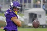 Minnesota Vikings wide receiver Adam Thielen celebrates his catch during NFL football training camp Friday, July 30, 2021, in Eagan, Minn. (AP Photo/Bruce Kluckhohn)