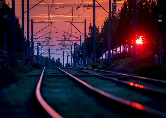 Rails of a subway line are seen in Frankfurt, Germany, as the sun rises Saturday, June 27, 2020. (AP Photo/Michael Probst)