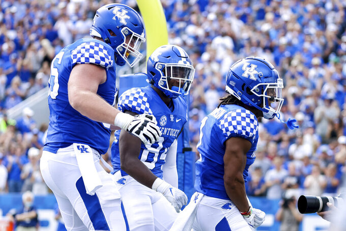 Kentucky's Wan'Dale Robinson, right, celebrates a touchdown during the first half of an NCAA college football game against Louisiana-Monroe in Lexington, Ky., Saturday, Sept. 4, 2021. (AP Photo/Michael Clubb)