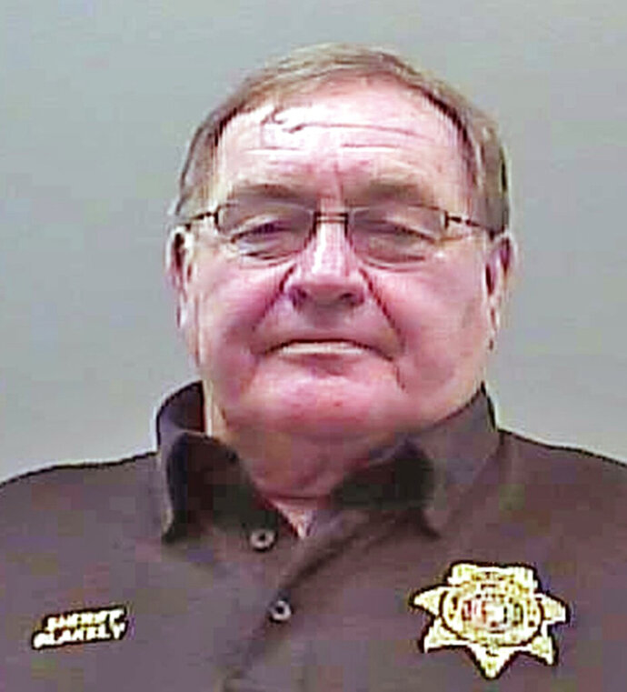 This booking photograph released by the Limestone Sheriff's Office shows Sheriff Mike Blakely following his arrest on theft and ethics charges on Thursday, Aug. 22, 2019. Blakely, who has been sheriff of the north Alabama county since 1983, was booked into his own jail and later released on $49,000 bail. (AP Photo/Limestone County Sheriff's Office)