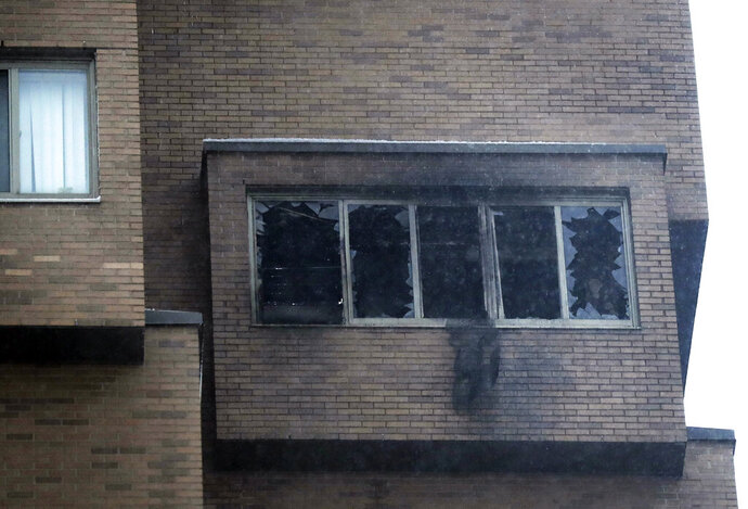 Broken windows and damage remain after a deadly fire at the high-rise apartment building Wednesday, Nov. 27, 2019, in Minneapolis. (David Joles/Star Tribune via AP)