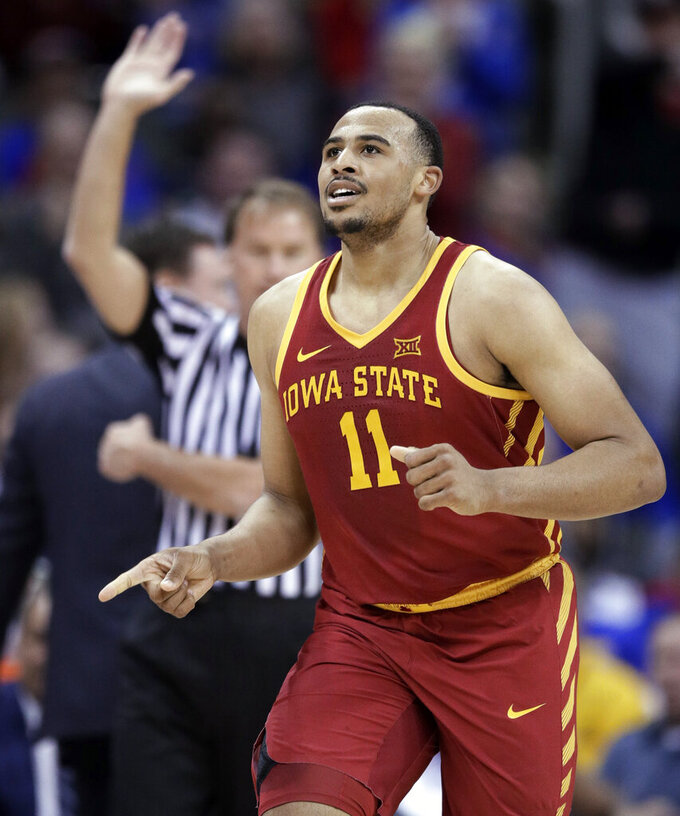 Iowa State guard Talen Horton-Tucker (11) celebrates a basket during the first half of the team's NCAA college basketball game against Kansas in the final of the Big 12 men's tournament in Kansas City, Mo., Saturday, March 16, 2019. (AP Photo/Orlin Wagner)