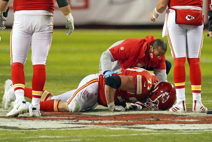 Kansas City Chiefs guard Andrew Wylie is helped by a trainer after getting injured during the second half of the AFC championship NFL football game against the Buffalo Bills, Sunday, Jan. 24, 2021, in Kansas City, Mo. (AP Photo/Charlie Riedel)