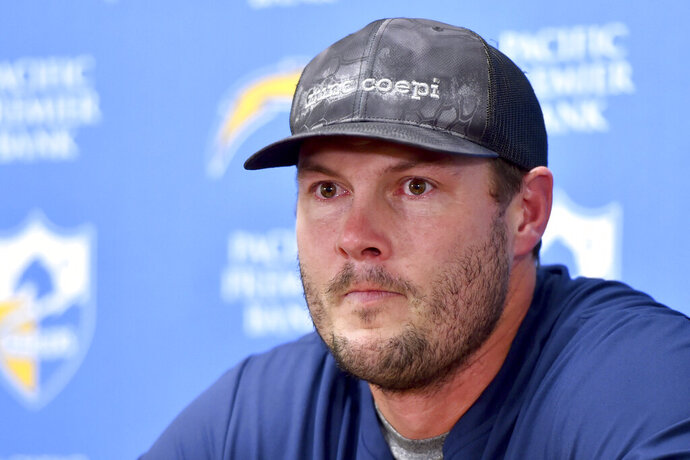 Los Angeles Chargers quarterback Philip Rivers reacts at a news conference following an NFL football game against the Kansas City Chiefs in Kansas City, Mo., Sunday, Dec. 29, 2019. (AP Photo/Ed Zurga)