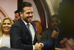 Puerto Rico's Gov. Ricardo Rossello arrives his commonwealth addressat the seaside Capitol in San Juan, Puerto Rico, Wednesday, April 24, 2019. He pledged on Wednesday to lift the U.S. territory from a deep recession by creating more jobs, reversing a migration exodus and implementing a range of incentives as the island struggles to recover from Hurricane Maria. (AP Photo/Carlos Giusti)