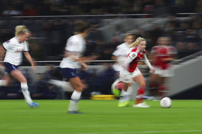 Arsenal's Beth Mead runs with the ball against Tottenham Hotspur, during their Women's Super League soccer match at the Tottenham Hotspur Stadium in London, Sunday Nov. 17, 2019.  The match drew a record crowd of 38,262 for the competition on Sunday when Arsenal claimed a 2-0 victory at Tottenham. (Zac Goodwin/PA via AP)