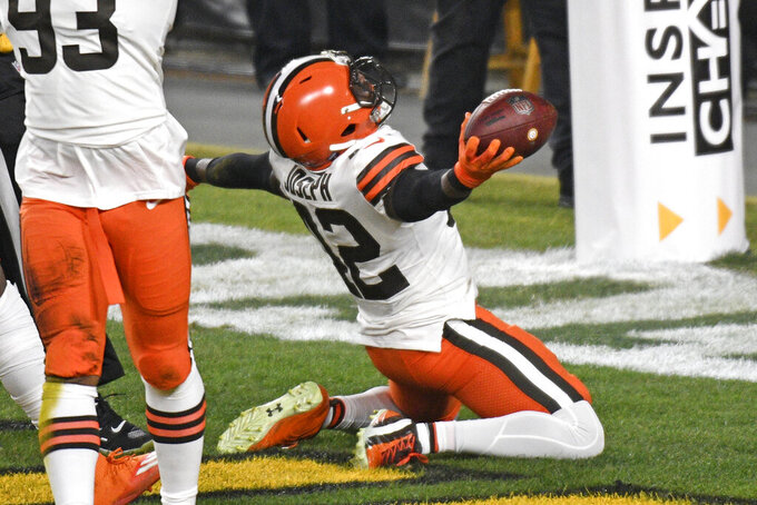 Cleveland Browns strong safety Karl Joseph (42) celebrates after recovering a fumbled in the end zone for a touchdown during the first half of an NFL wild-card playoff football game against the Pittsburgh Steelers in Pittsburgh, Sunday, Jan. 10, 2021. (AP Photo/Don Wright)