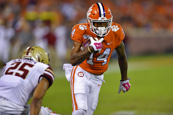 Clemson's Diondre Overton rushes for a touchdown after a reception while defended by Boston College's Mehdi El Attrach during the first half of an NCAA college football game Saturday, Oct. 26, 2019, in Clemson, S.C. (AP Photo/Richard Shiro)