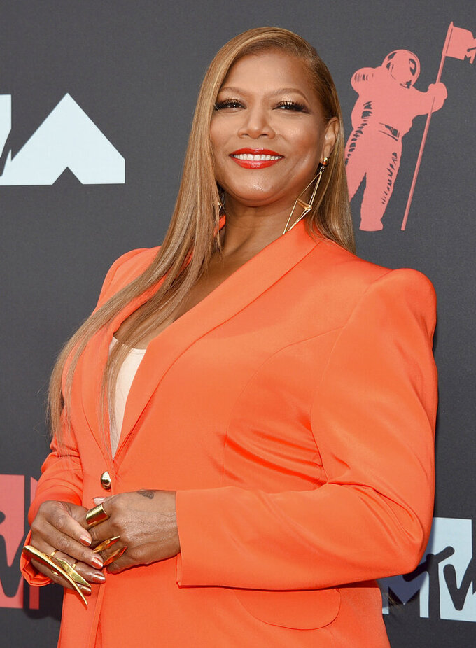 FILE - Queen Latifah arrives at the MTV Video Music Awards on Aug. 26, 2019, in Newark, N.J. Queen Latifah will be honored at Sunday's BET Awards. (Photo by Evan Agostini/Invision/AP, File)
