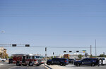 Power lines are seen above the site of a fatal balloon crash in Albuquerque, N.M., Saturday, June 26, 2021.  Multiple people were killed in the crash.  (AP Photo/Andres Leighton)