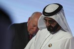 Sheikh Mohammed bin Rashid Al Maktoum, Dubai Ruler and UAE Prime Minister, right, leaves after the speech of Former U.S. Vice President Dick Cheney at the Arab Strategy Forum in Dubai, United Arab Emirates, Monday, Dec. 9, 2019. Dubai's ruler, Sheikh Mohammed bin Rashid Al Maktoum, attended the talk by Cheney, showing the respect still afforded to the 78-year-old former vice president. Cheney made a point himself to describe the UAE as