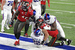 New York Giants' Wayne Gallman (22) scores a touchdown during the first half of an NFL football game against the Tampa Bay Buccaneers, Tuesday, Nov. 3, 2020, in East Rutherford, N.J. (AP Photo/Bill Kostroun)