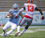 North Carolina quarterback Sam Howell (7) slides under Syracuse's Mikel Jones (13) after a short gain in the fourth quarter of an NCAA college football game Saturday, Sept. 12, 2020, in Chapel Hill, N.C. (Robert Willett/The News & Observer via AP, Pool)