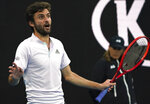 France's Gilles Simon gestures during his second round singles match against Australia's Nick Kyrgios at the Australian Open tennis championship in Melbourne, Australia, Thursday, Jan. 23, 2020. (AP Photo/Lee Jin-man)