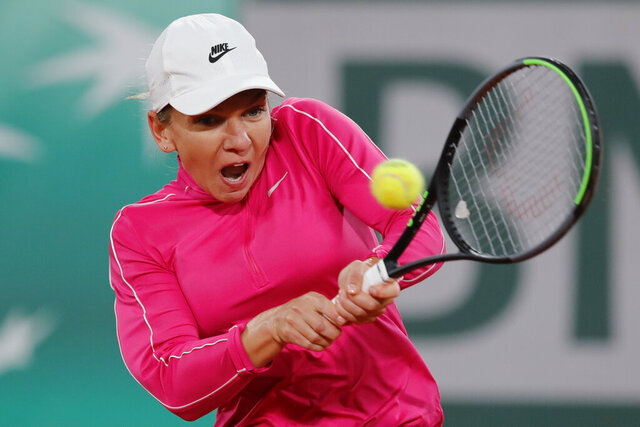 Romania's Simona Halep plays a shot against Spain's Sara Sorribes Tormo in the first round match of the French Open tennis tournament at the Roland Garros stadium in Paris, France, Sunday, Sept. 27, 2020. (AP Photo/Christophe Ena)