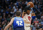 Portland Trail Blazers forward Carmelo Anthony (00) is defended by Dallas Mavericks forward Maxi Kleber (42) during the second half of an NBA basketball game Friday, Jan. 17, 2020, in Dallas. Dallas won 120-112. (AP Photo/Brandon Wade)