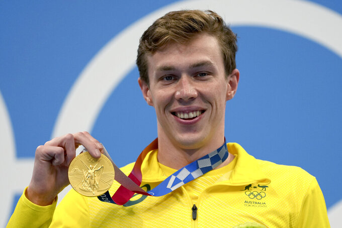 Izaac Stubbblety-Cook of Australia poses with his gold medal after winning the men's 200-meter breaststroke final at the 2020 Summer Olympics, Thursday, July 29, 2021, in Tokyo, Japan. (AP Photo/Matthias Schrader)
