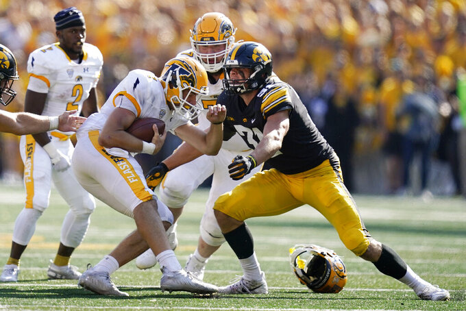 FILE - Kent State quarterback Dustin Crum (7) is sacked by Iowa linebacker Jack Campbell (31) during the first half of an NCAA college football game in Iowa City, Iowa, in this Saturday, Sept. 18, 2021, file photo. Iowa linebacker Jack Campbell has become a one-man wrecking crew. He's the Hawkeyes' leading tackler by far, his scoop and score broke open the Hawkeyes' win over Iowa State, and his fumble recovery set up the tying touchdown in a come-from-behind win over Colorado State. (AP Photo/Charlie Neibergall, File)