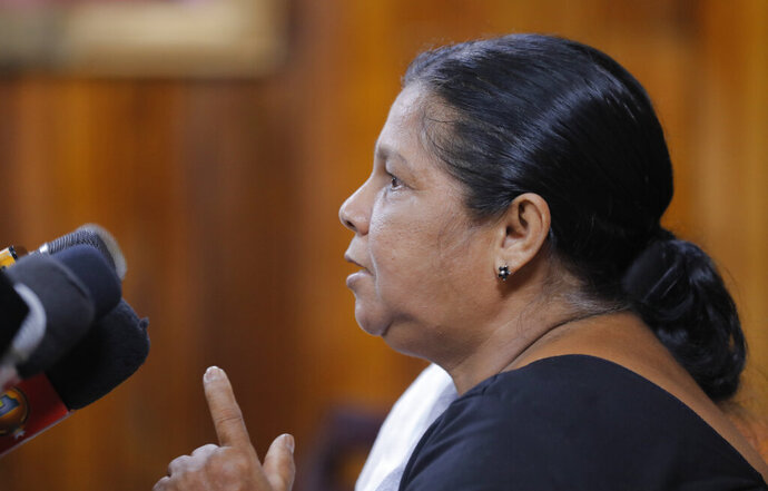 Sandya Ekneligoda, the wife of abducted Sri Lankan journalist Prageeth Ekneligoda addresses the media in Colombo, Sri Lanka, Tuesday, Dec. 31, 2019. Prageeth went missing in 2010 during the presidency of Mahinda Rajapaksa, the brother of current President Gotabaya Rajapaksa. (AP Photo/Eranga Jayawardena)
