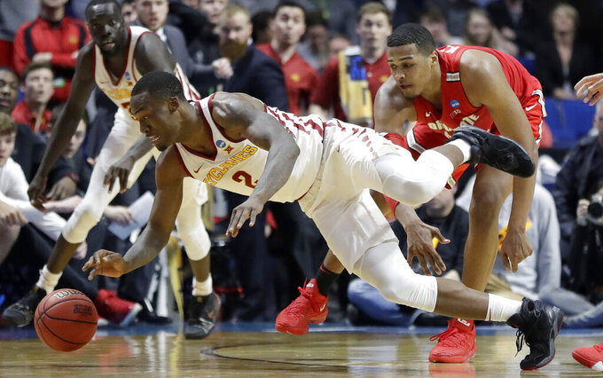Iowa State's Cameron Lard, left, dives after a loose ball as Ohio State's Kaleb Wesson watches during the second half of a first round men's college basketball game in the NCAA Tournament Friday, March 22, 2019, in Tulsa, Okla. Ohio State won 62-59. (AP Photo/Jeff Roberson)