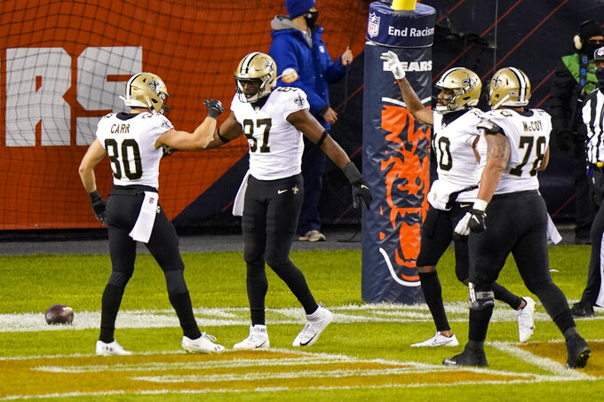 New Orleans Saints tight end Jared Cook (87) celebrates a touchdown with wide receiver Austin Carr (80) in the first half of an NFL football game against the Chicago Bears in Chicago, Sunday, Nov. 1, 2020. (AP Photo/Nam Y. Huh)