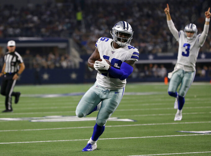 Dallas Cowboys running back Jordan Chunn (46) runs the ball for a touchdown as quarterback Mike White (3) celebrates in the second half of a preseason NFL football game agains the Houston Texans in Arlington, Texas, Saturday, Aug. 24, 2019. (AP Photo/Michael Ainsworth)
