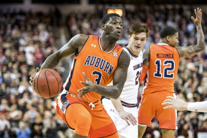 Auburn forward Danjel Purifoy (3) dribbles the ball during the first half of an NCAA college basketball game against South Carolina Tuesday, Jan. 22, 2019, in Columbia, S.C. (AP Photo/Sean Rayford)