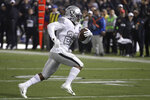 Oakland Raiders running back Josh Jacobs runs on the way to a touchdown against the Los Angeles Chargers during the second half of an NFL football game in Oakland, Calif., Thursday, Nov. 7, 2019. (AP Photo/Ben Margot)