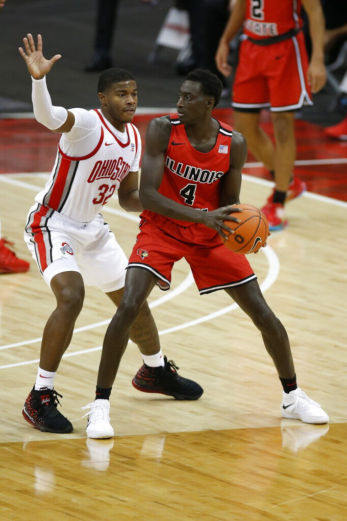 Illinois State's Abdou Ndiaye, right, looks for an open pass as Ohio State's E.J. Liddell defends during the first half of an NCAA college basketball game Wednesday, Nov. 25, 2020, in Columbus, Ohio. (AP Photo/Jay LaPrete)