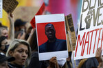 A protester holds an image of George Floyd during a march Thursday, June 4, 2020, in San Diego. Protests continue to be held in U.S. cities, sparked by the death of Floyd, a black man who died after being restrained by Minneapolis police officers on May 25. (AP Photo/Gregory Bull)