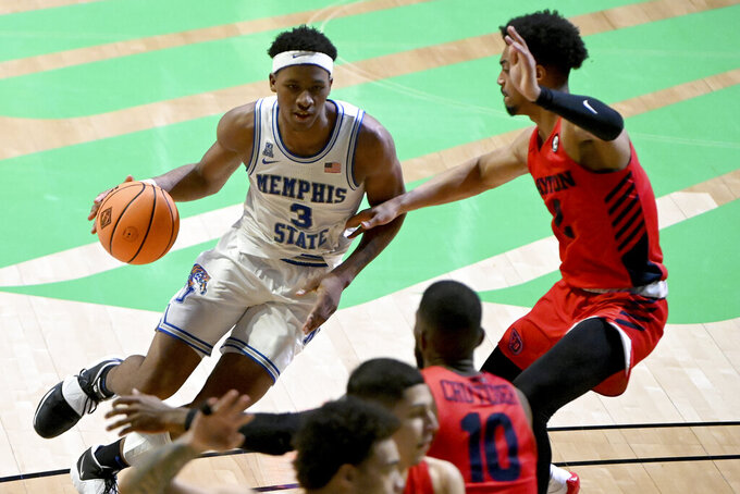 Memphis guard Landers Nolley II (3) drives on Dayton guard Ibi Watson (2) in the second half of an NCAA college basketball game in the first round of the NIT Tournament, Saturday, March 20, 2021, in Denton, Texas. Memphis won 71-60. (AP Photo/Matt Strasen)