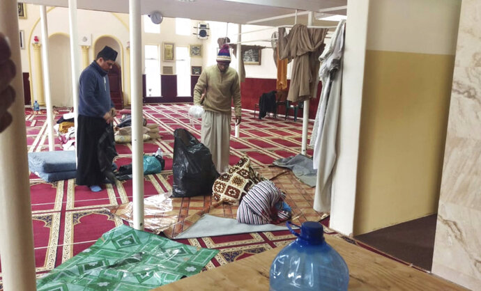 The scene inside the Malmesbury Mosque during a clean up operation near Cape Town South Africa, Thursday June 14, 2018. A man fatally stabbed two people on Thursday and wounded several others at a mosque near Cape Town before police shot and killed the attacker, authorities said.(AP Photo/Nasief Manie)