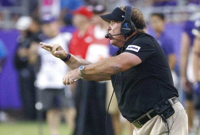 TCU head coach Gary Patterson calls a play against Duquesne during the second half of an NCAA college football game Saturday, Sept. 4, 2021, in Fort Worth, Texas. (AP Photo/Ron Jenkins)
