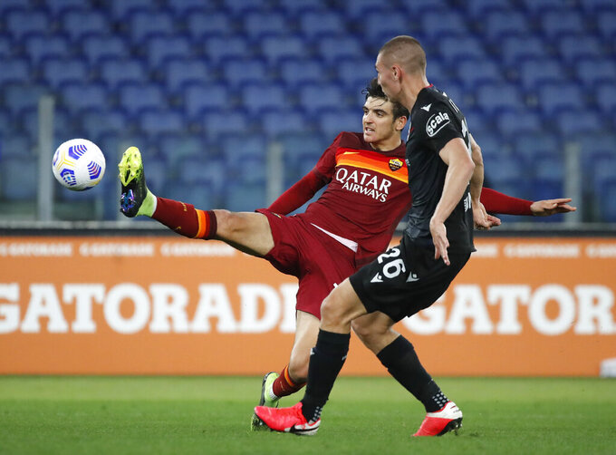 Roma's Gonzalo Villar, left, and Bologna's Valentin Anton challenge for the ball during the Italian Serie A soccer match between Roma and Bologna at Rome's Olympic stadium, Italy, Sunday, April 11, 2021. (AP Photo/Alessandra Tarantino)