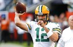 Green Bay Packers' Aaron Rodgers warms up before an NFL football game against the Chicago Bears Thursday, Sept. 5, 2019, in Chicago. (AP Photo/Charles Rex Arbogast)