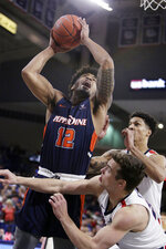 Pepperdine forward Darnell Dunn (12) shoots over Gonzaga forward Corey Kispert, front right, and forward Brandon Clarke during the first half of an NCAA college basketball game in Spokane, Wash., Thursday, Feb. 21, 2019. (AP Photo/Young Kwak)