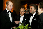 Britain's Prince William, left, talks with David Beckham, second right, during the global premiere of Netflix's
