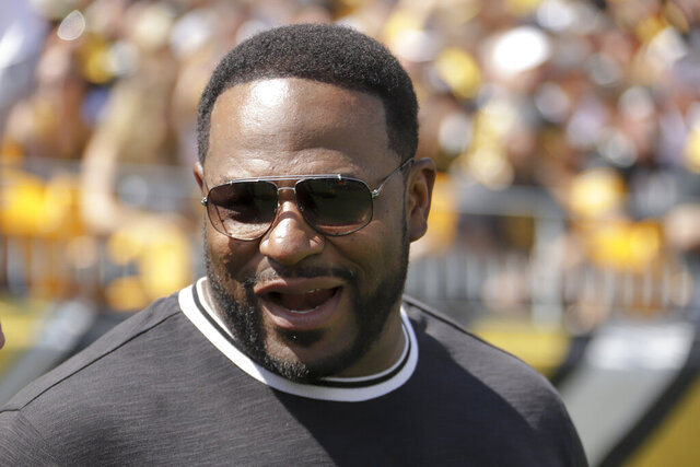 FILE - In this Sept. 15, 2019, file photo, former Pittsburgh Steelers running back Jerome Bettis watches the Steelers play against the Seattle Seahawks in the first half of an NFL football game, in Pittsburgh. The Hall of Fame running back has filed a racial discrimination lawsuit against a Pittsburgh company he had promoted for its commitment to diversity. (AP Photo/Gene J. Puskar, File)